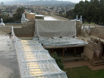 BEFORE: Hollyhock House leaky roofs, temporary cover during rainfall.  <br /> <br /> During these years, we were searching for funding to restore this Frank Lloyd Wright masterpiece.  Fortunately, we applied for grants and were awarded funds by the California Cultural and Historical Endowment, and a Save Americas Treasures grant that is administered by the National Park Service (Department of the Interior).  Once we were awarded the grants, the City's Bureau of Engineering and the Department of Recreation and Parks provided the required matching funds, and Phase III of this project could now begin.