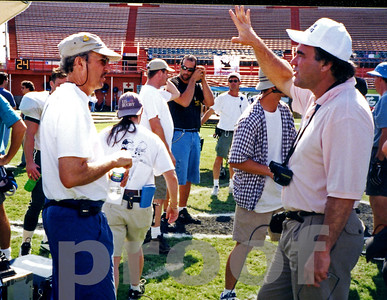 Chuck Cohen and Oliver Stone on the set of Any Given Sunday
