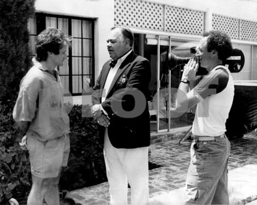 Robin Williams and Jonathan Winters being filmed by Chuck Cohen for the 60-Minutes profile of Robin.  This image was taken during filming at Mr. Winters home in backyard by his tennis court.  Chuck is shooting with his Aaton 16mm film camera.