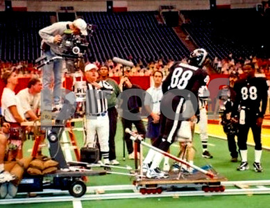 Chuck Cohen, 2nd Unit Director of Photography, operates a shot on the movie Any Given Sunday, in Dallas Cowboys' Texas Stadium.