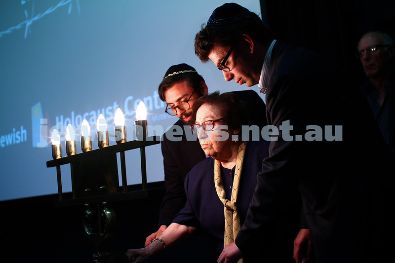 27-1-15. Holocaust Memorial Day. 70th anniversary of the liberation of Auschwitz. Commemoration at the Melbourne Holocaust Museum and Research Centre.  Frieda Schweitzer and her grandsons light one of the six memorial candles. Photo: Peter Haskin