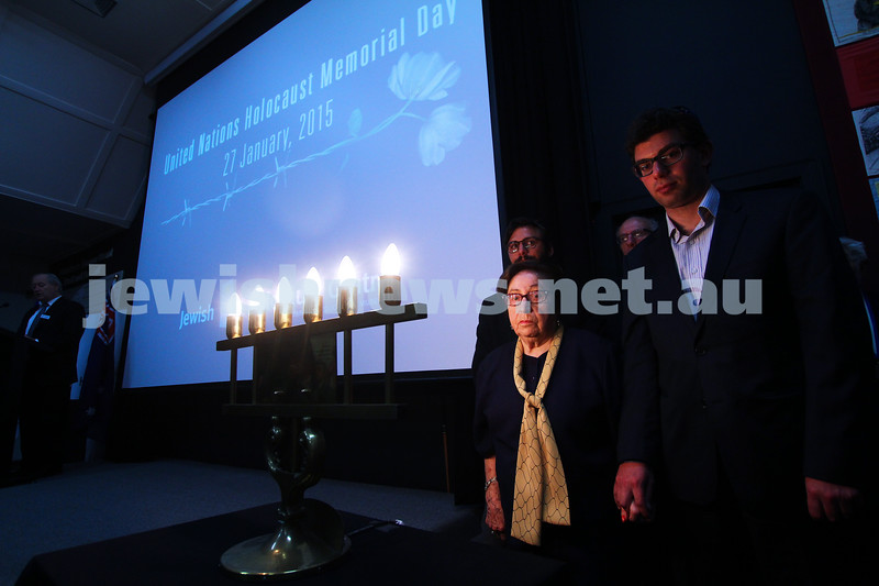 27-1-15. Holocaust Memorial Day. 70th anniversary of the liberation of Auschwitz. Commemoration at the Melbourne Holocaust Museum and Research Centre.  Frieda Schweitzer with her grandsons. Lighting memorial candles. Photo: Peter Haskin