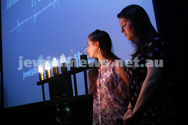 27-1-15. Holocaust Memorial Day. 70th anniversary of the liberation of Auschwitz. Commemoration at the Melbourne Holocaust Museum and Research Centre.  Lighting memorial candles. Photo: Peter Haskin