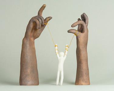 "9_Butler_""Hands of God"""