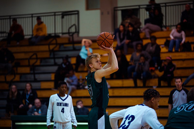 Holy Family Boys Varsity Basketball vs. Brooklyn Center, 12/5/19: Noah Seck '21 (30)