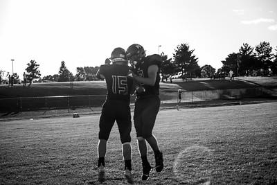 Holy Family Varsity Football vs. Mound Westonka, 8/29/19: Captain Nick Hendler '20 (15) & Thomas Guyer '21 (19)