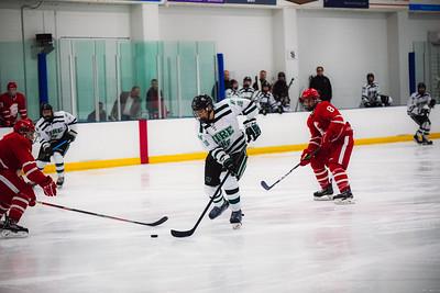 Holy Family Boys Varsity Hockey vs. Benilde-St. Margaret's, 12/26/19: Spencer Lewin '21 (18)