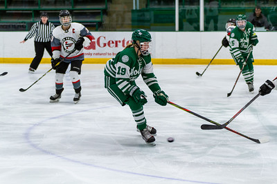 Holy Family's Grayson Limke '23 (19) vs. Eden Prairie at Braemar Arena - Collin Nawrocki/The Phoenix