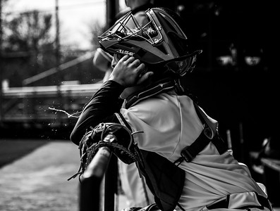 Holy Family catcher Rhett Johnson spits while in the dugout before a game against Delano on May 3, 2021
