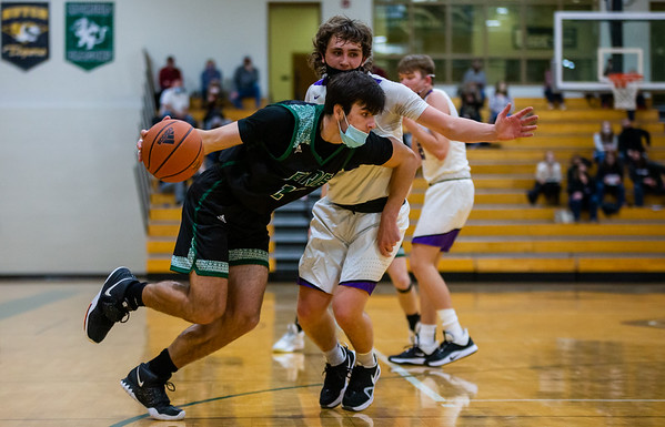 Holy Family's Jake Kirsch '21 (12) during a basketball game versus Glencoe-Silver Lake. The Fire won the game 28-17 on Saturday, January 16, 2021 at Holy Family Catholic High School