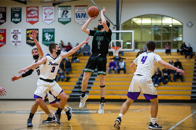 Holy Family's Gavin Lund '21 (2) during a basketball game versus Glencoe-Silver Lake. The Fire won the game 28-17 on Saturday, January 16, 2021 at Holy Family Catholic High School