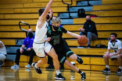 Holy Family's Noah Seck '21 (30) during a basketball game versus Glencoe-Silver Lake. The Fire won the game 28-17 on Saturday, January 16, 2021 at Holy Family Catholic High School