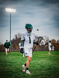 Tanner Theis (1) tosses a ball before a lacrosse game versus Saint Louis Park on April 26, 2021.