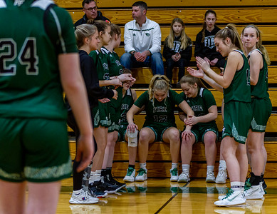 Holy Family's Captain Grace Elander '20 (12) and Nicole Bowlin '23 (23) vs. Maple Lake at Section 5AA Round of 16 - Collin Nawrocki/The Phoenix