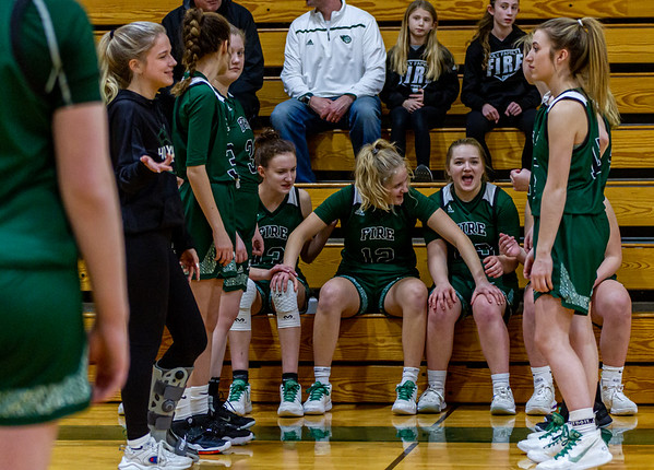 Holy Family's Sophia Hall '23 (13), Captain Grace Elander '20 (12) and Nicole Bowlin '23 (23) vs. Maple Lake at Section 5AA Round of 16 - Collin Nawrocki/The Phoenix