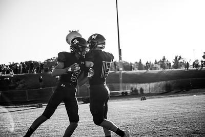 Holy Family Varsity Football vs. Mound Westonka, 8/29/19: Lucas Lembke '20 (5) & Captain Nick Hendler '20 (15)