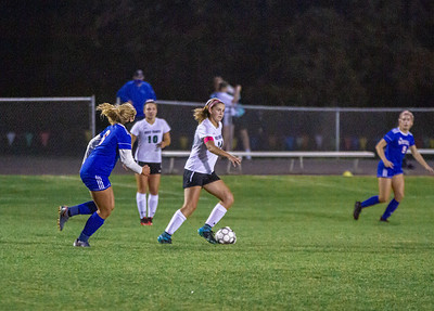 Holy Family's Sophie Paul '21 (16) during a Wright County Conference matchup against Watertown-Mayer High School. Collin Nawrocki - The Phoenix