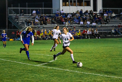 Holy Family's Gabby Legg '24 (22) during a Wright County Conference matchup against Watertown-Mayer High School. Collin Nawrocki - The Phoenix