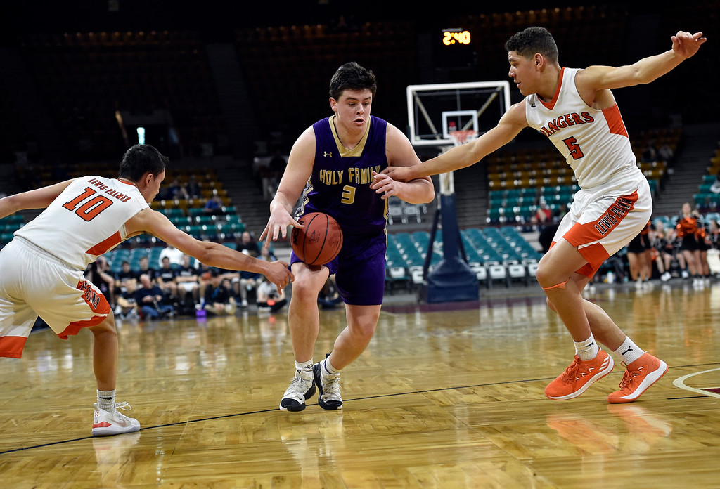 . DENVER, CO - MARCH 8, 2019: Holy Family High School\'s Kyle Helbig gets the ball stripped by Noah Baca during a CHSAA 4A Final Four playoff game against Lewis Palmer on Friday at the Denver Coliseum. Holy Family lost the game. More photos: BoCoPreps.com (Photo by Jeremy Papasso/Staff Photographer)