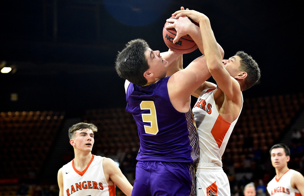 . DENVER, CO - MARCH 8, 2019: Holy Family High School\'s Kyle Helbig fights for a rebound with Joel Scott during a CHSAA 4A Final Four playoff game against Lewis Palmer on Friday at the Denver Coliseum. Holy Family lost the game. More photos: BoCoPreps.com (Photo by Jeremy Papasso/Staff Photographer)