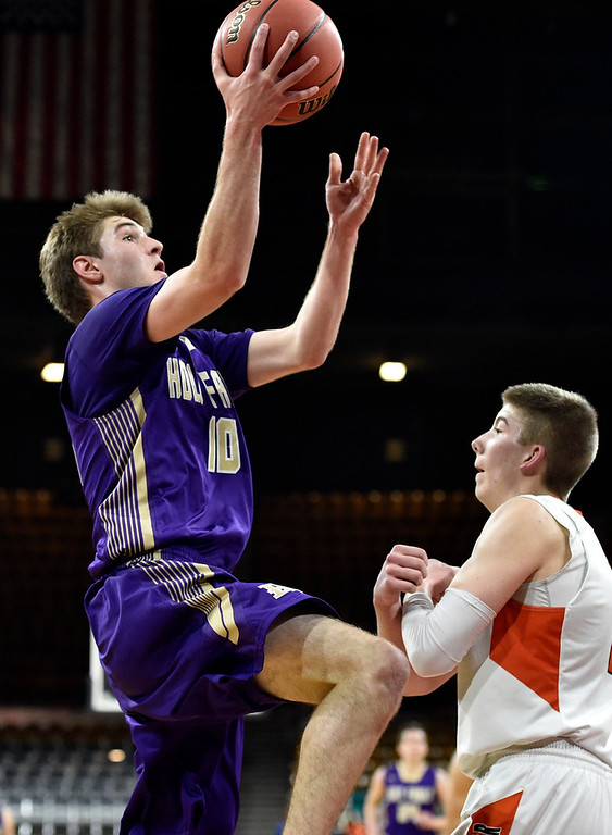 . DENVER, CO - MARCH 8, 2019: Holy Family High School\'s Tanner Baird drives to the hoop during a CHSAA 4A Final Four playoff game against Lewis Palmer on Friday at the Denver Coliseum. Holy Family lost the game. More photos: BoCoPreps.com (Photo by Jeremy Papasso/Staff Photographer)