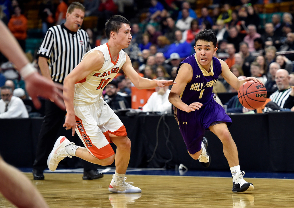 . DENVER, CO - MARCH 8, 2019: Holy Family High School\'s Dominic Nellis dribbles past Noah Baca during a CHSAA 4A Final Four playoff game against Lewis Palmer on Friday at the Denver Coliseum. Holy Family lost the game. More photos: BoCoPreps.com (Photo by Jeremy Papasso/Staff Photographer)