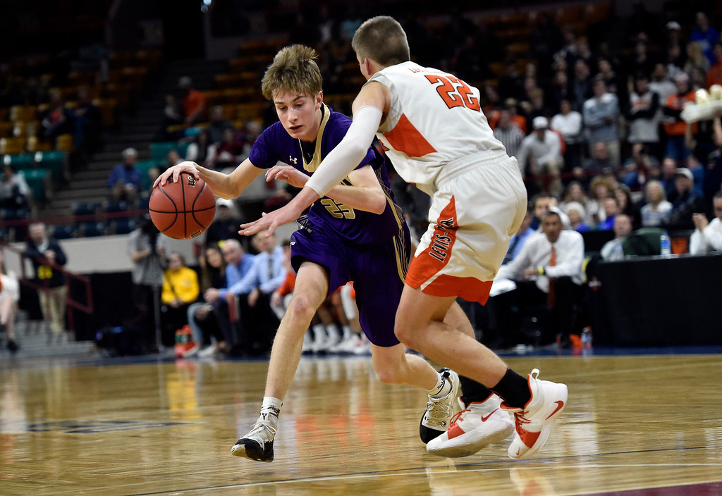 . DENVER, CO - MARCH 8, 2019: Holy Family High School\'s Garrett Green dribbles past Matthew Ragsdale during a CHSAA 4A Final Four playoff game against Lewis Palmer on Friday at the Denver Coliseum. Holy Family lost the game. More photos: BoCoPreps.com (Photo by Jeremy Papasso/Staff Photographer)