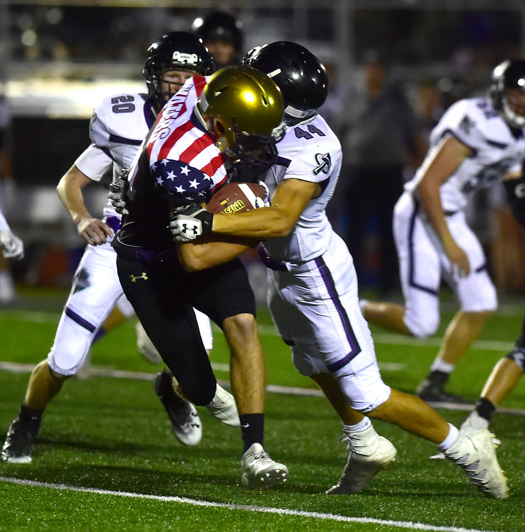 . BROOMFIELD CO - SEPTEMBER 14 2018 Holy Family High School\'s Braeden Peters gets taken down by Discovery Canyon High\'s Tanner McCrary during their game in Broomfield on Friday September 14, 2018. More photos bocopreps.com  (Photo by Paul Aiken/Staff Photographer)