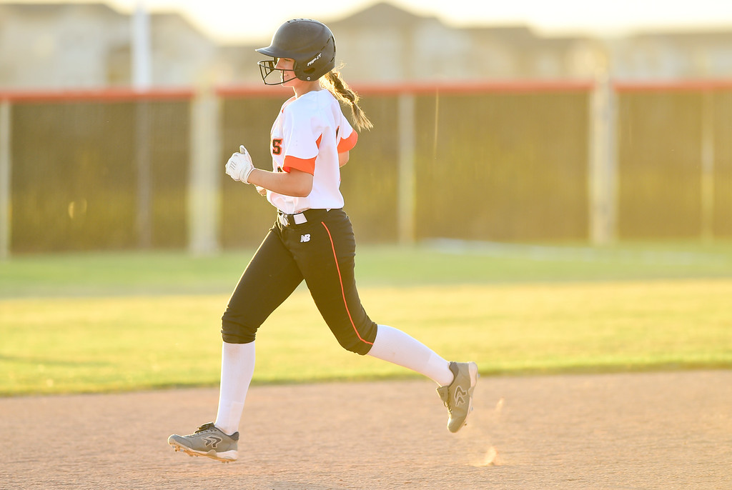 . ERIE, CO - SEPTEMBER 18:Erie High School\'s Kambry Fraser (No. 21) jogs the bases after hitting a 2 run home run to defeat Holy Family High School in Erie on Sept. 18, 2018. Erie defeated Holy Family, 11-9. (Photo by Matthew Jonas/Staff Photographer)