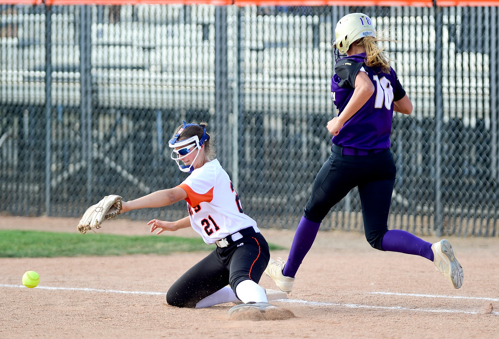 . ERIE, CO - SEPTEMBER 18:Erie High School\'s Kambry Fraser (No. 21) can\'t make the catch before Holy Family High School\'s Noelle Gardon (No. 18) makes it to first in Erie on Sept. 18, 2018. Erie defeated Holy Family, 11-9. (Photo by Matthew Jonas/Staff Photographer)