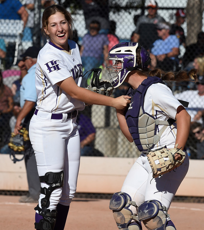 . AURORA, CO - October 20, 2018: Erin Caviness, left, and Abby Edwards, of Holy Family, celebrate another well pitched inning.  Holy Family beats Mountain View to win the 4A State Softball Championship in Aurora on Saturday.  (Photo by Cliff Grassmick/Staff Photographer)