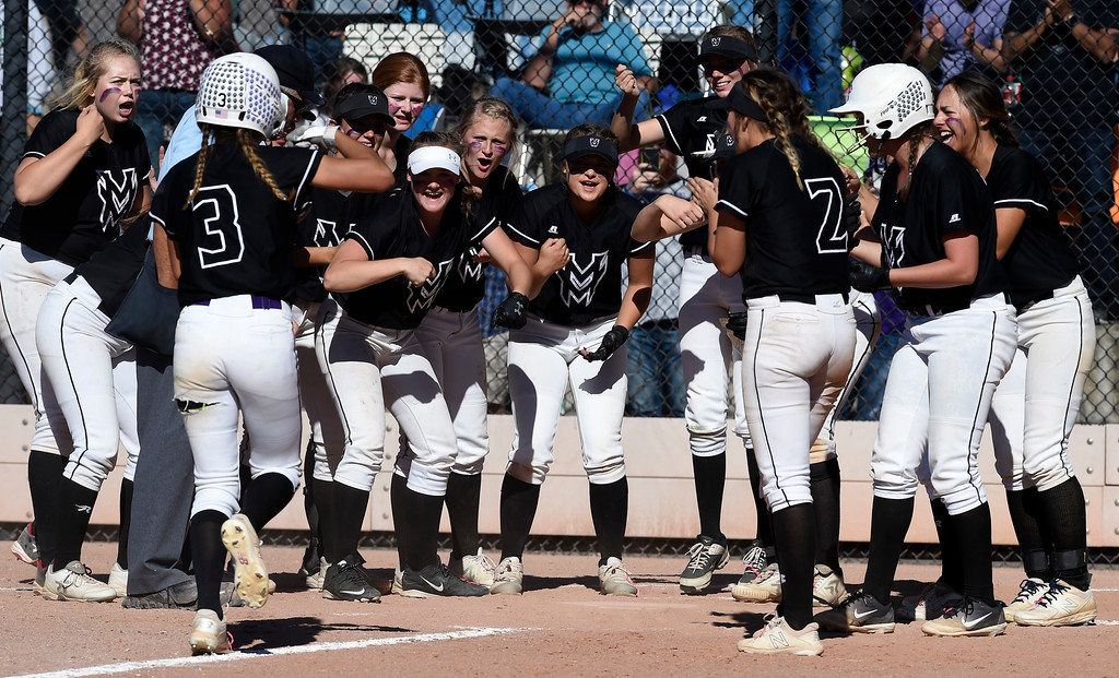. AURORA, CO - October 20, 2018: Jaelyn Taylor, of Mountain View, is greeted by her teammates after hitting a home run.  Holy Family beats Mountain View to win the 4A State Softball Championship in Aurora on Saturday.  (Photo by Cliff Grassmick/Staff Photographer)