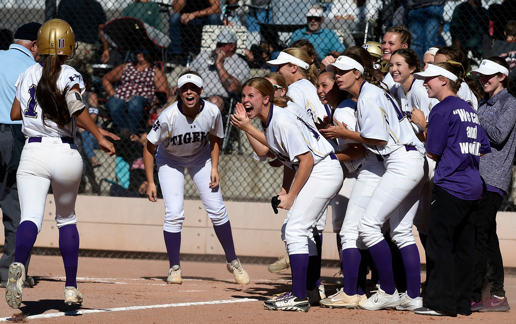 . AURORA, CO - October 20, 2018:  Anna Martinez, of Holy Family, is greeted by her teammates after her home run. Holy Family beats Mountain View to win the 4A State Softball Championship in Aurora on Saturday.  (Photo by Cliff Grassmick/Staff Photographer)