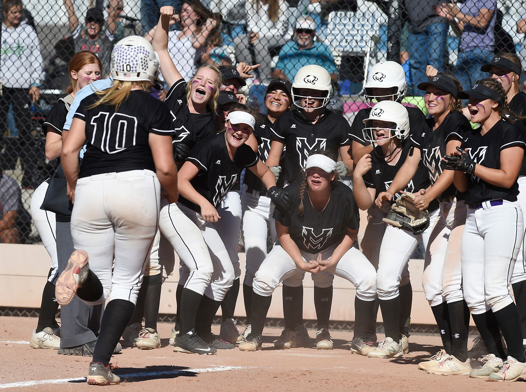 . AURORA, CO - October 20, 2018:  Mountain View players wait to celebrate the home run with Bailey Carlson. Holy Family beats Mountain View to win the 4A State Softball Championship in Aurora on Saturday.  (Photo by Cliff Grassmick/Staff Photographer)