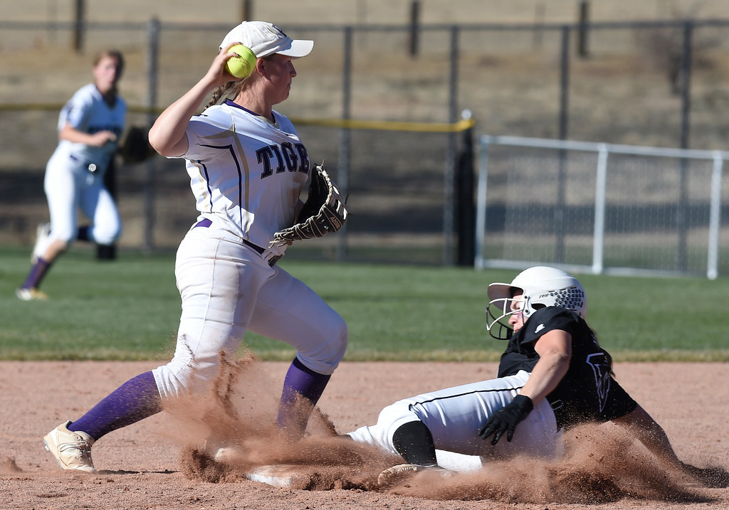 . AURORA, CO - October 20, 2018: Sara Rode, of Holy Family, tries to turn the double play, getting RaLeigh Basart, of Mountain View, out at second.  Holy Family beats Mountain View to win the 4A State Softball Championship in Aurora on Saturday.  (Photo by Cliff Grassmick/Staff Photographer)