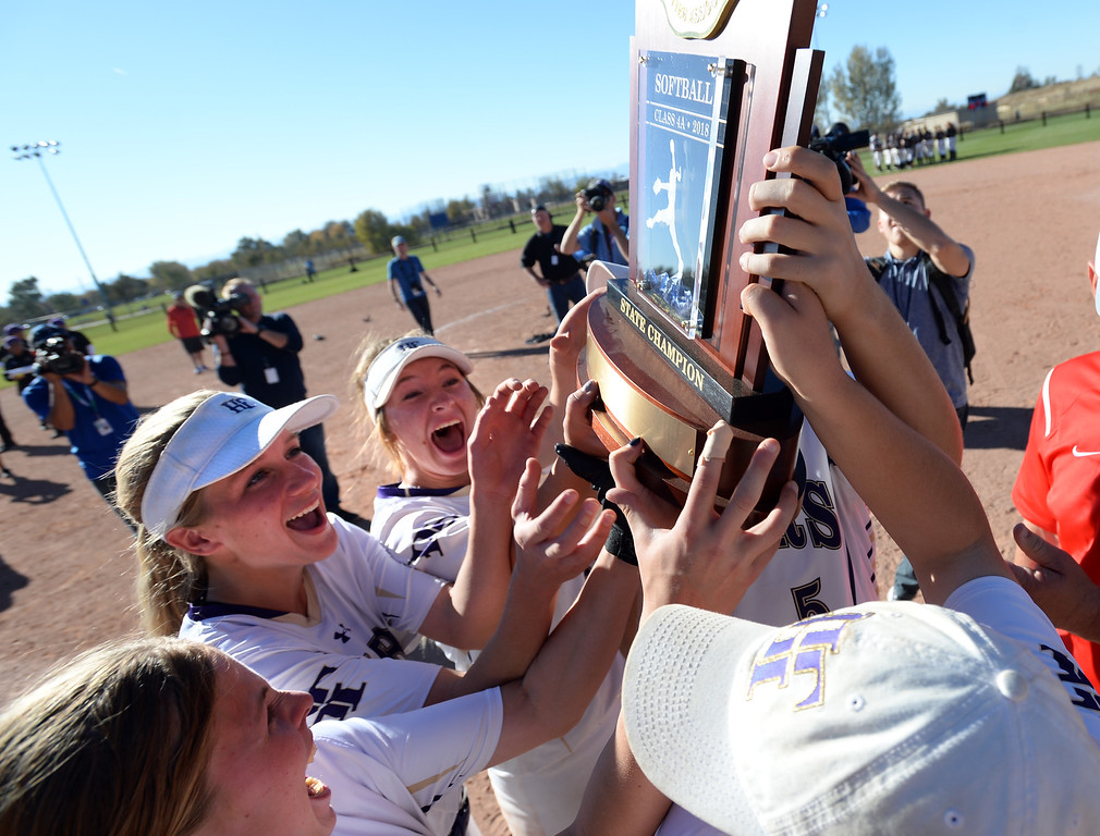 . AURORA, CO - October 20, 2018: Holy Family players lift up the State Championship trophy. Holy Family beats Mountain View to win the 4A State Softball Championship in Aurora on Saturday.  (Photo by Cliff Grassmick/Staff Photographer)