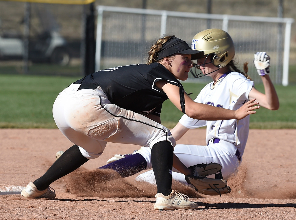 . AURORA, CO - October 20, 2018: Kamryn Leoffler, of Mountain View, tries to get the out at second of Tyler Whitlock, of Holy Family.  Holy Family beats Mountain View to win the 4A State Softball Championship in Aurora on Saturday.  (Photo by Cliff Grassmick/Staff Photographer)
