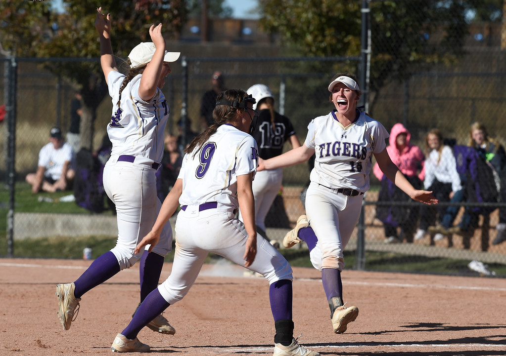 . AURORA, CO - October 20, 2018: Erin Winters, right, of Holy Family,  celebrates with her teammates after the final out to win the state championship.Holy Family beats Mountain View to win the 4A State Softball Championship in Aurora on Saturday.  (Photo by Cliff Grassmick/Staff Photographer)