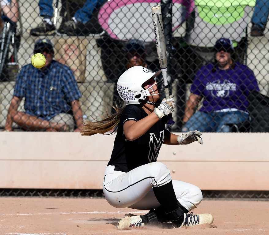 . AURORA, CO - October 20, 2018:  Nya Chacon, of Mountain View, gets hit in the back by a pitch. Holy Family beats Mountain View to win the 4A State Softball Championship in Aurora on Saturday.  (Photo by Cliff Grassmick/Staff Photographer)