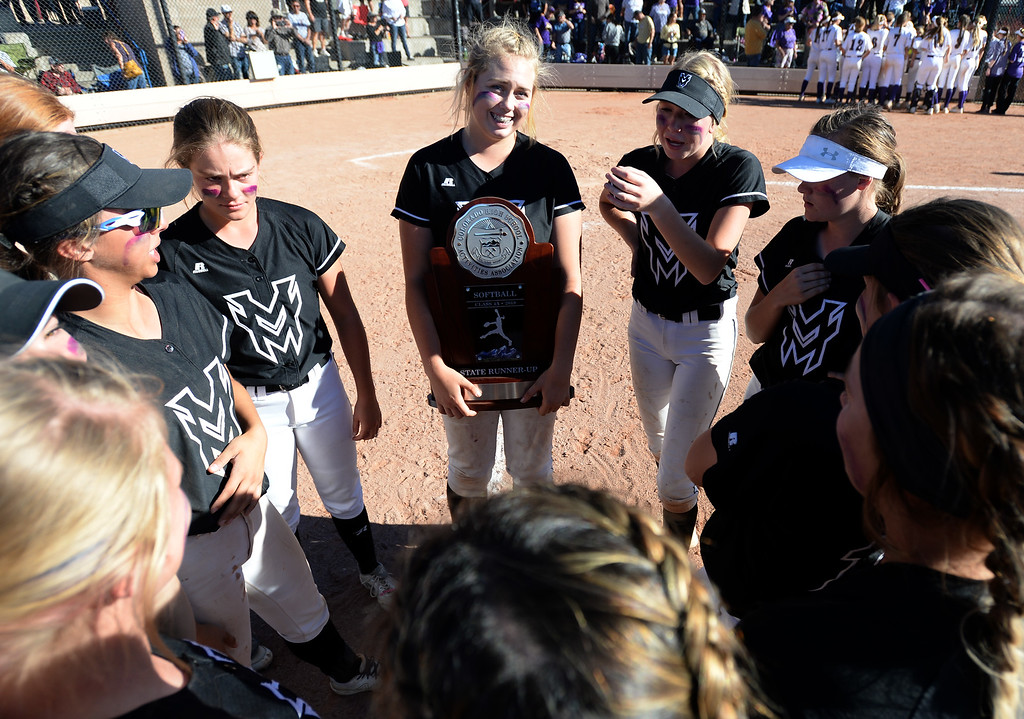 . AURORA, CO - October 20, 2018:  Bailey Carlson, of Mountain View, holds the runner up trophy. Holy Family beats Mountain View to win the 4A State Softball Championship in Aurora on Saturday.  (Photo by Cliff Grassmick/Staff Photographer)