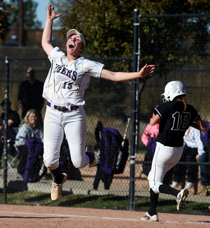 . AURORA, CO - October 20, 2018:  Erin Winters, of Holy Family, jumps for joy after her team got the last out to win the state championship.  Holy Family beats Mountain View to win the 4A State Softball Championship in Aurora on Saturday.  (Photo by Cliff Grassmick/Staff Photographer)