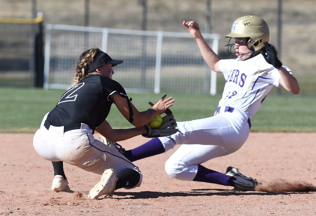 . AURORA, CO - October 20, 2018: Kamryn Leoffler, of Mountain View, tries to get the out at second of Kaitlyn McKenzie, of Holy Family.   Holy Family beats Mountain View to win the 4A State Softball Championship in Aurora on Saturday.  (Photo by Cliff Grassmick/Staff Photographer)