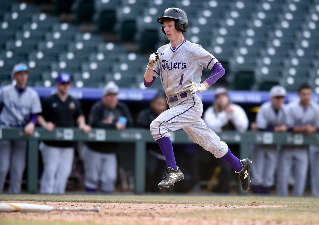 . DENVER, CO - MARCH 18, 2019: Holy Family High School\'s Davis Martinek runs home to score during a non-conference game against Conifer on Monday at Coors Field in Denver. For more photos of the game go to: BoCoPreps.com (Photo by Jeremy Papasso/Staff Photographer)