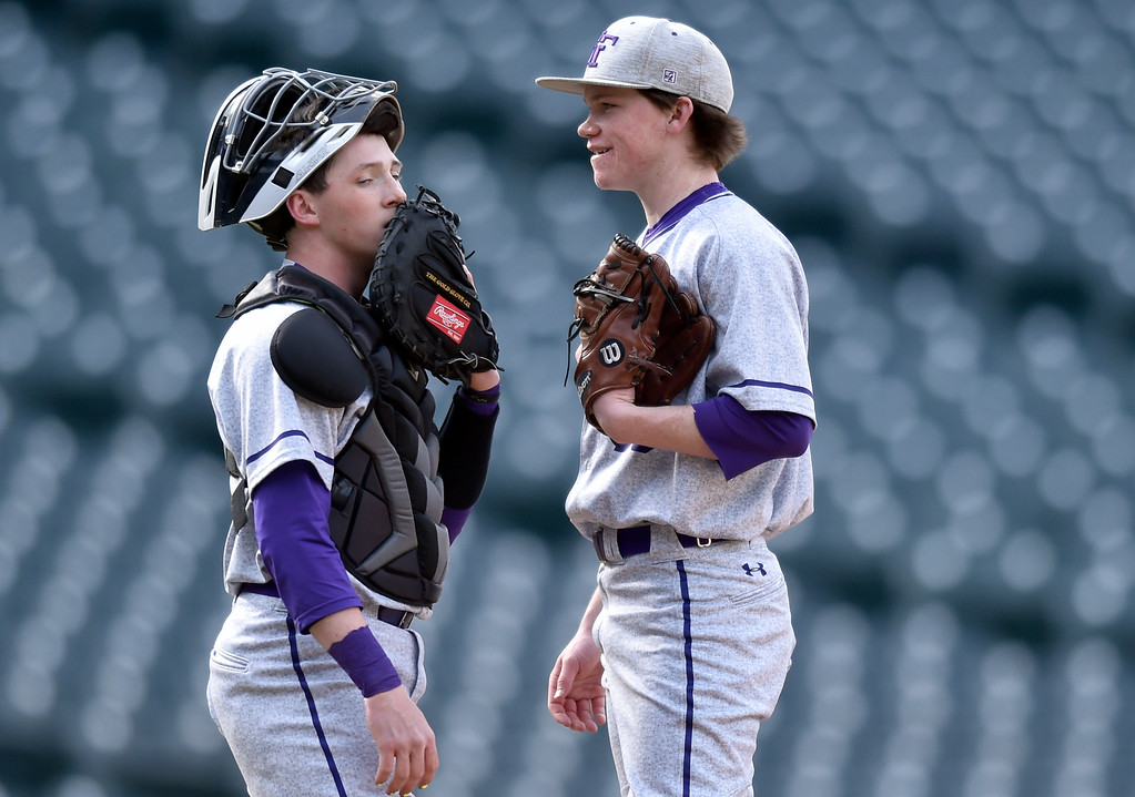 . DENVER, CO - MARCH 18, 2019: Holy Family High School pitcher Weston Siefken, at right, talks with catcher Bobby Ziegler between pitches during a non-conference game against Conifer on Monday at Coors Field in Denver. For more photos of the game go to: BoCoPreps.com (Photo by Jeremy Papasso/Staff Photographer)
