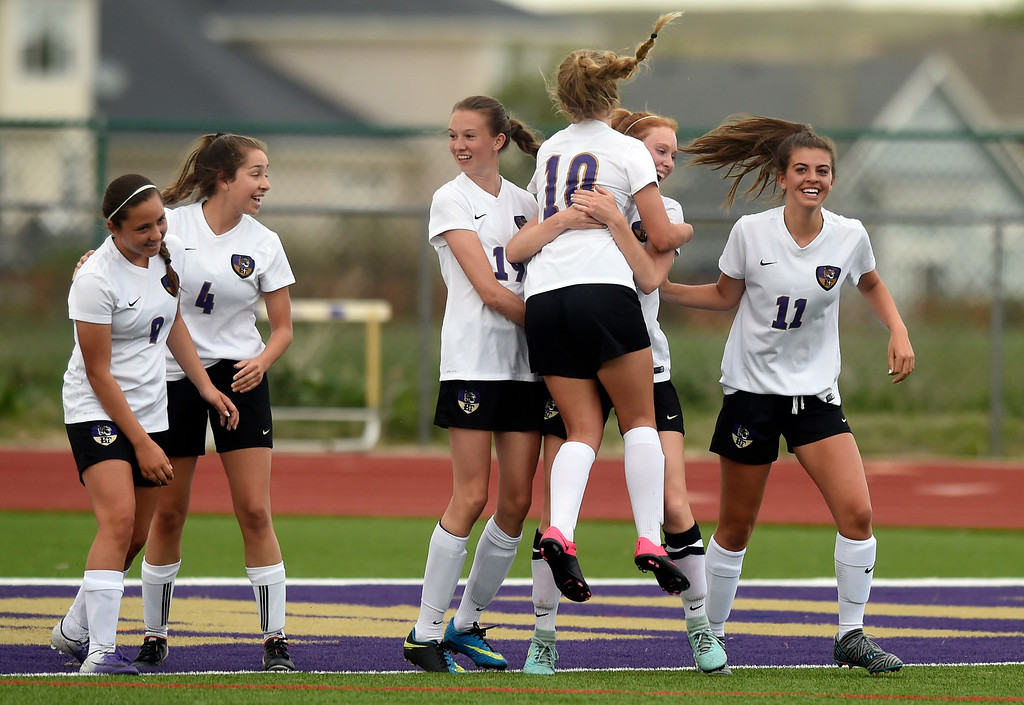. Holy Family High School\'s Kika Napierkowski is congratulated on a goal by teammate Kody Clements during a CHSAA first-round playoff game against Elizabeth on Wednesday in Broomfield. More photos: BoCoPreps.com Jeremy Papasso/ Staff Photographer 05/09/2018