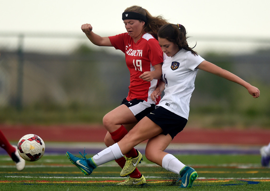 . Holy Family High School\'s Lauren Clingman passes the ball upfield during a CHSAA first-round playoff game against Elizabeth on Wednesday in Broomfield. More photos: BoCoPreps.com Jeremy Papasso/ Staff Photographer 05/09/2018