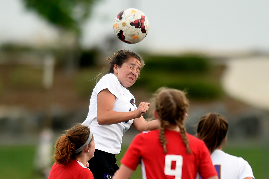 . Holy Family High School\'s Nicolette Sandoval heads the ball during a CHSAA first-round playoff game against Elizabeth on Wednesday in Broomfield. More photos: BoCoPreps.com Jeremy Papasso/ Staff Photographer 05/09/2018