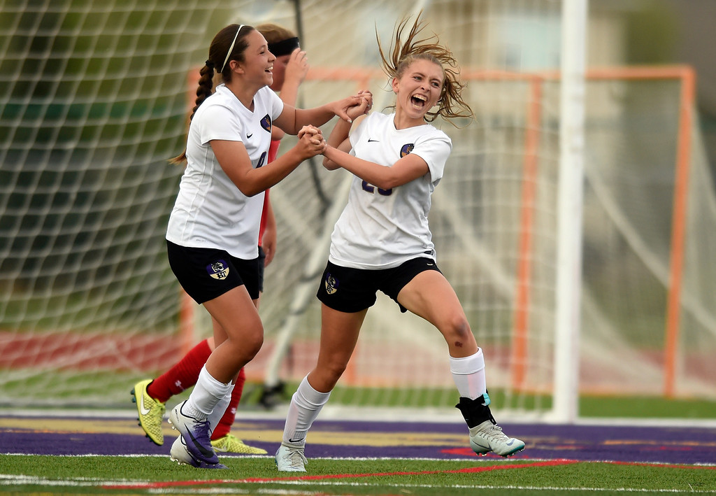. Holy Family High School\'s Bailey Sloan, at right, celebrates a goal with teammate Jailen Giron during a CHSAA first-round playoff game against Elizabeth on Wednesday in Broomfield. More photos: BoCoPreps.com Jeremy Papasso/ Staff Photographer 05/09/2018