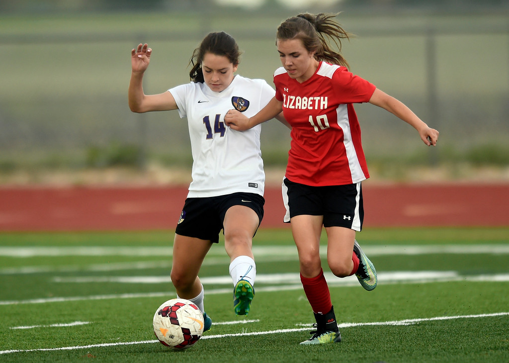 . Holy Family High School\'s Lauren Clingman fights for the ball with Rachel Melchoir during a CHSAA first-round playoff game against Elizabeth on Wednesday in Broomfield. More photos: BoCoPreps.com Jeremy Papasso/ Staff Photographer 05/09/2018