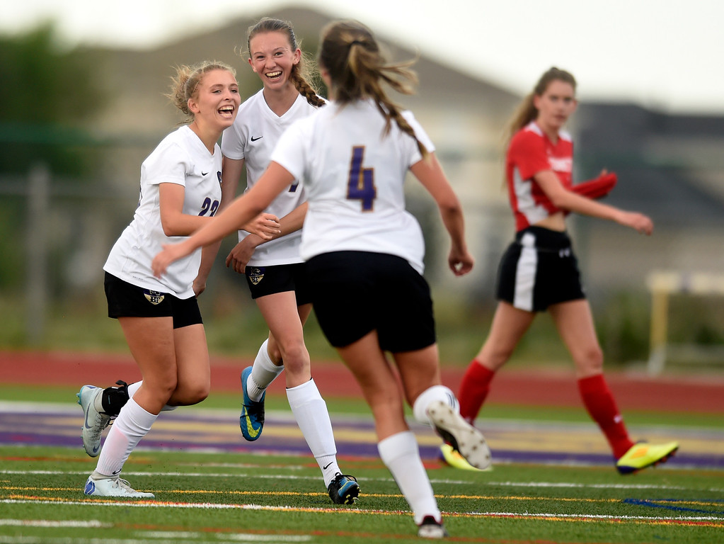 . Holy Family High School\'s Bailey Sloan, left, celebrates a goal with teammates during a CHSAA first-round playoff game against Elizabeth on Wednesday in Broomfield. More photos: BoCoPreps.com Jeremy Papasso/ Staff Photographer 05/09/2018